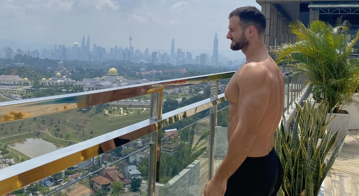 Emil Hodzovic Extreme Kettlebell Instructor viewing the whole city from a tall building